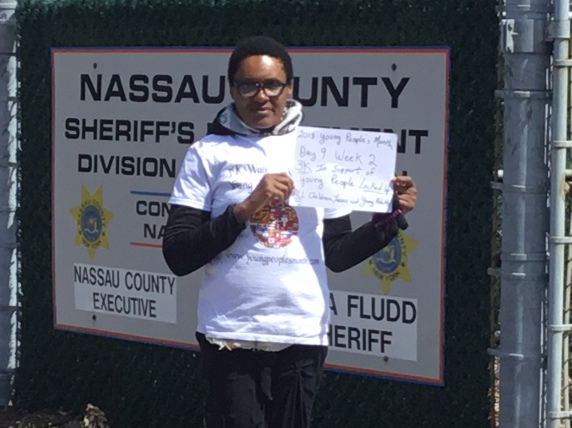 PIX NASSAU COUNTY JAIL ME CLOSE UP WITH SIGN